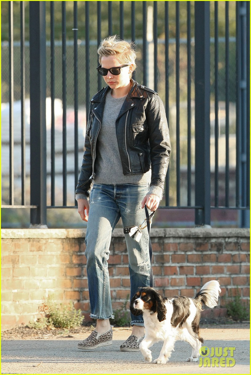 michelle williams goes leather jacket chic for dog walk 052956078