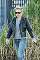 michelle williams goes leather jacket chic for dog walk 03