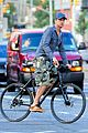 gerard butler camouflages bike ride in nyc 05