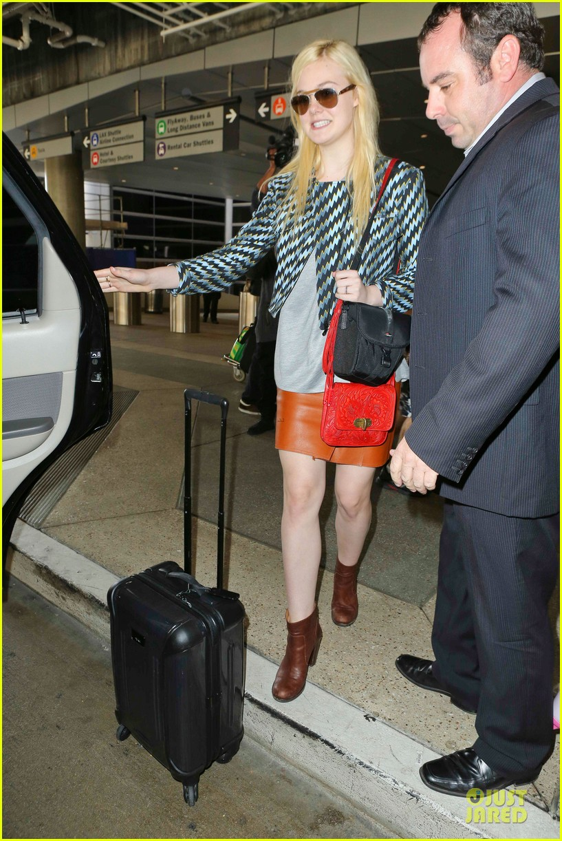 dakota fanning separate landings after paris fashion week 072966198