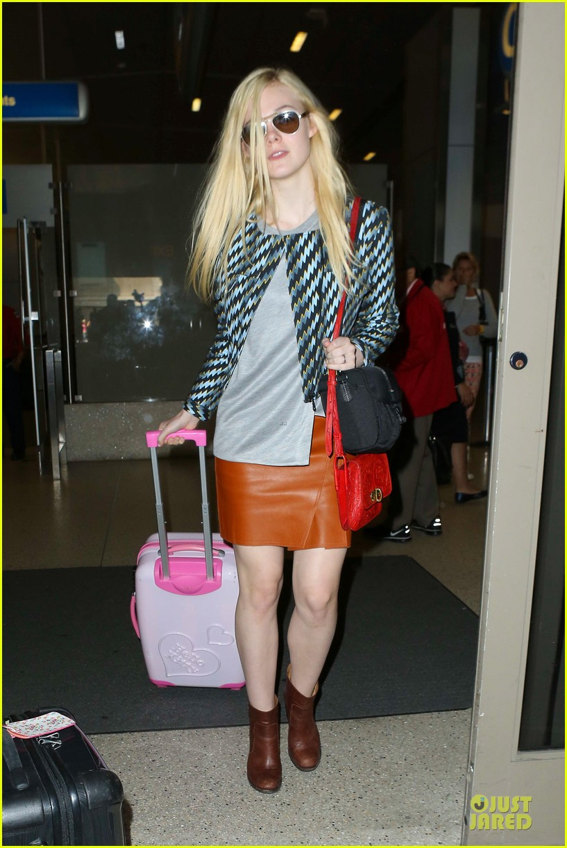 dakota fanning separate landings after paris fashion week 082966199