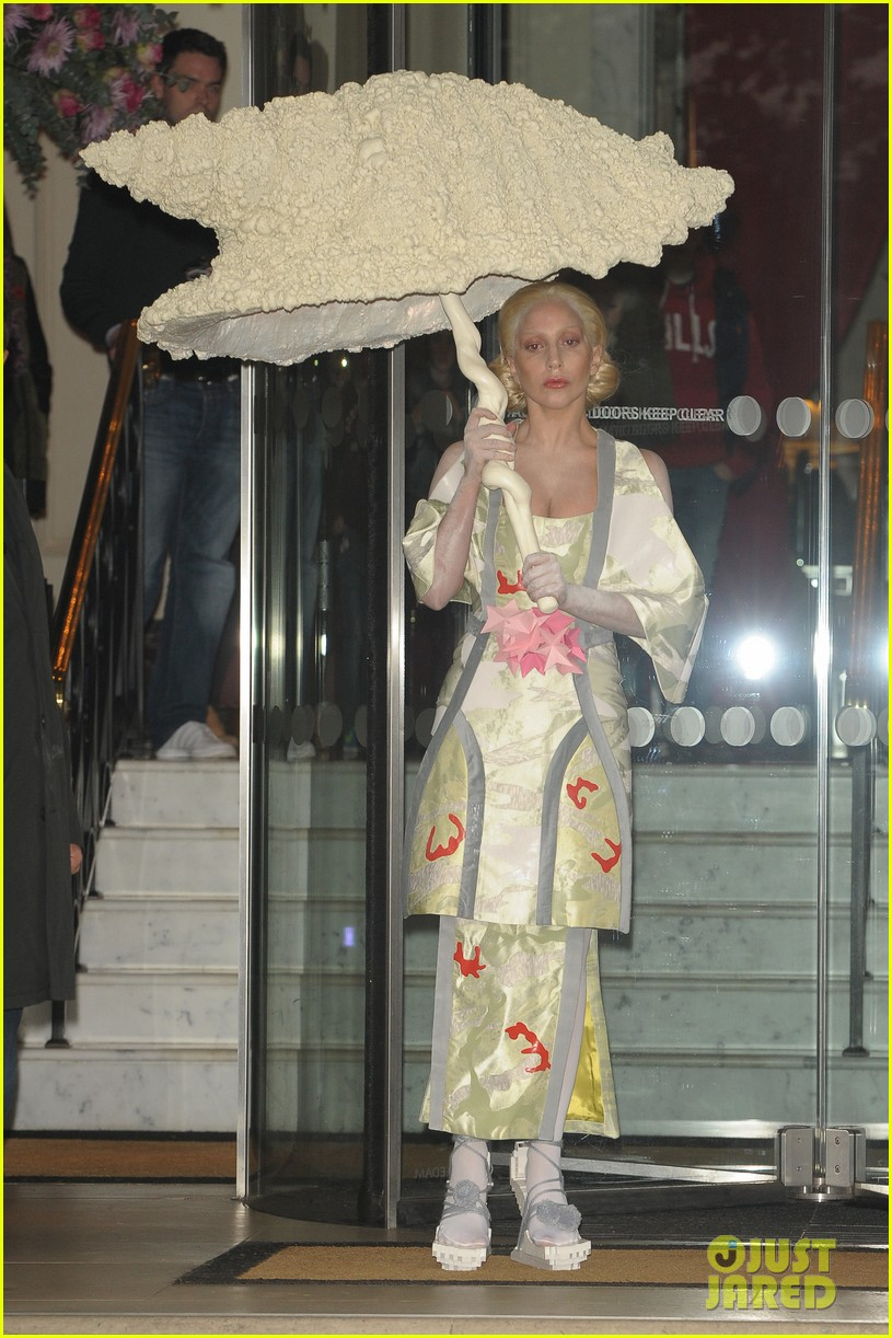 lady gaga carries large seashell umbrella around london 01