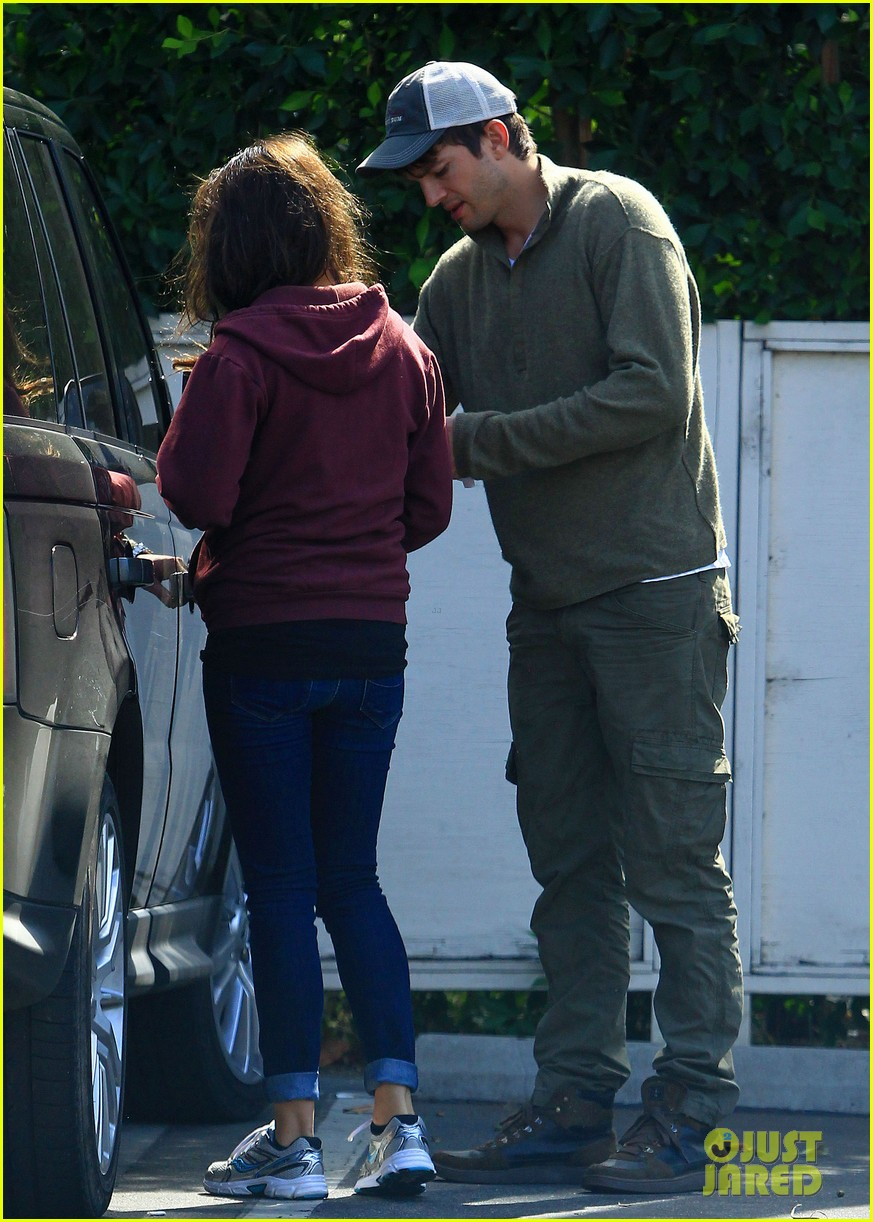 ashton kutchers opens car door for mila kunis 01
