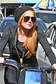lindsay lohan citibikes with mom dina 04