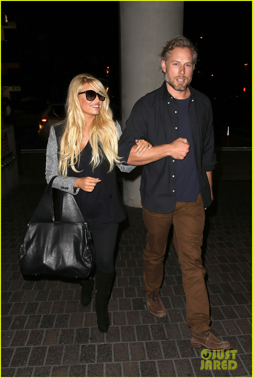 jessica simpson links arms with eric johnson at airport 012971798