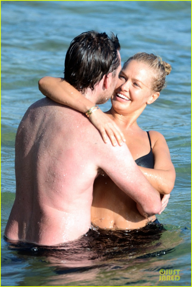 shirtless sam worthington laura bingle beach kissing couple 332969743