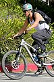 josh duhamel bares his biceps in muscle tank on bike ride 15