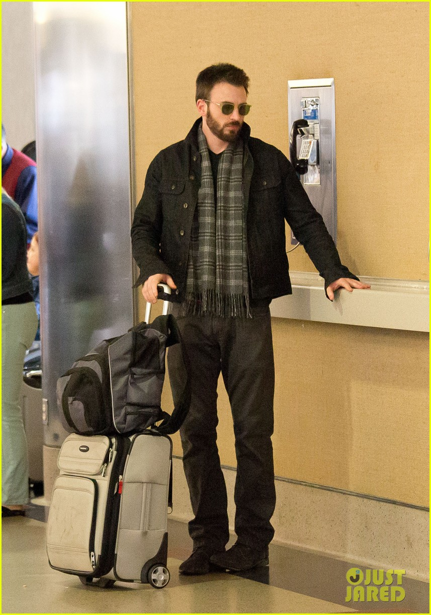 chris evans steps out after split from minka kelly 062989635