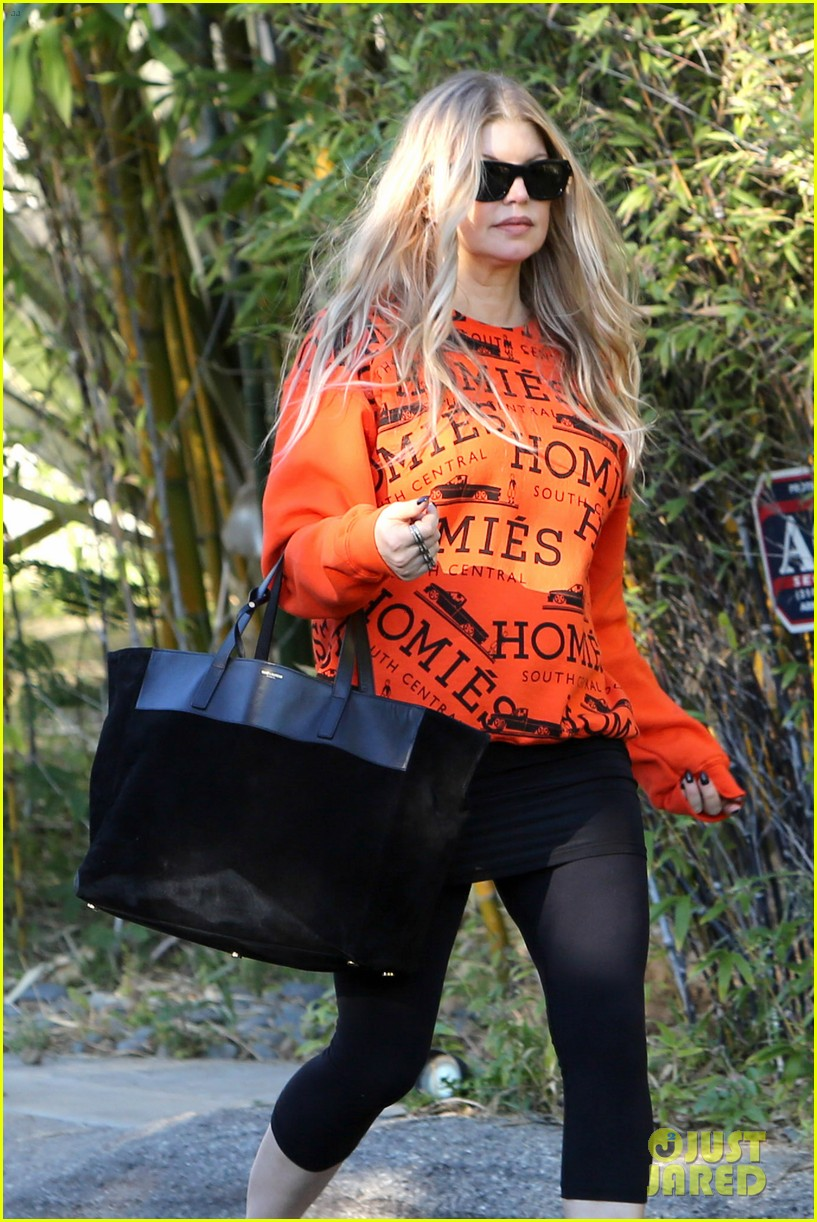 fergie halloween festive in orange sweatshirt 06