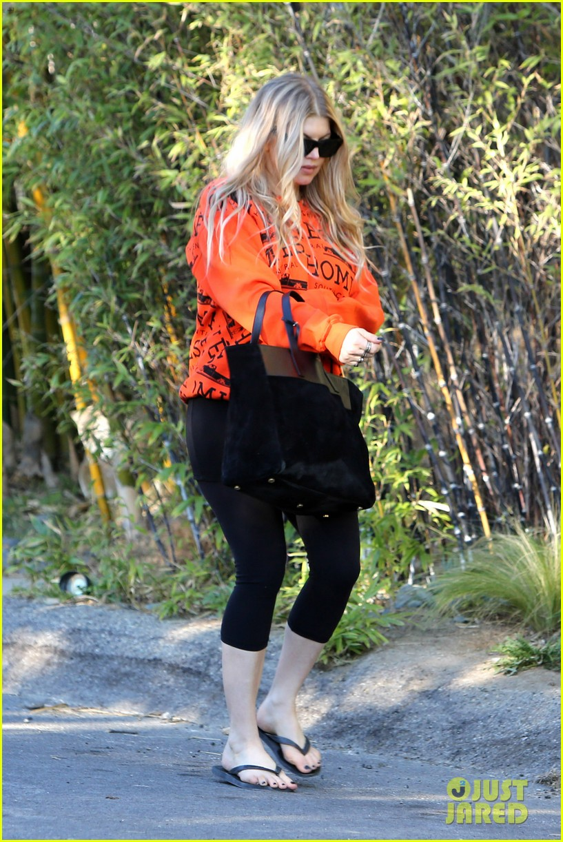 fergie halloween festive in orange sweatshirt 12