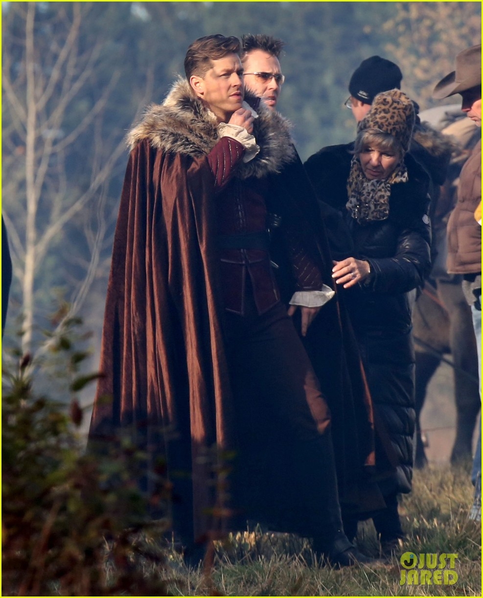 ginnifer goodwin cradles baby bump kisses josh dallas on set 073002077