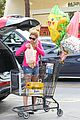 ashley greene leaves store with balloons party supplies 12