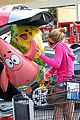 ashley greene leaves store with balloons party supplies 15
