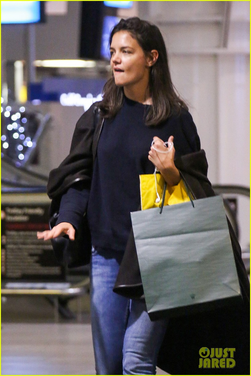 katie holmes arrives back in south africa 03