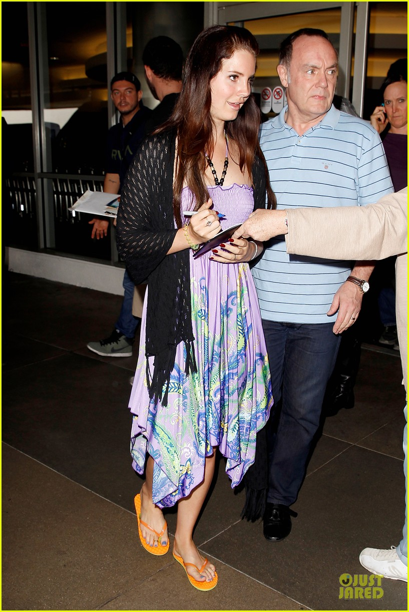 lana del rey receives flowers at lax airport 05