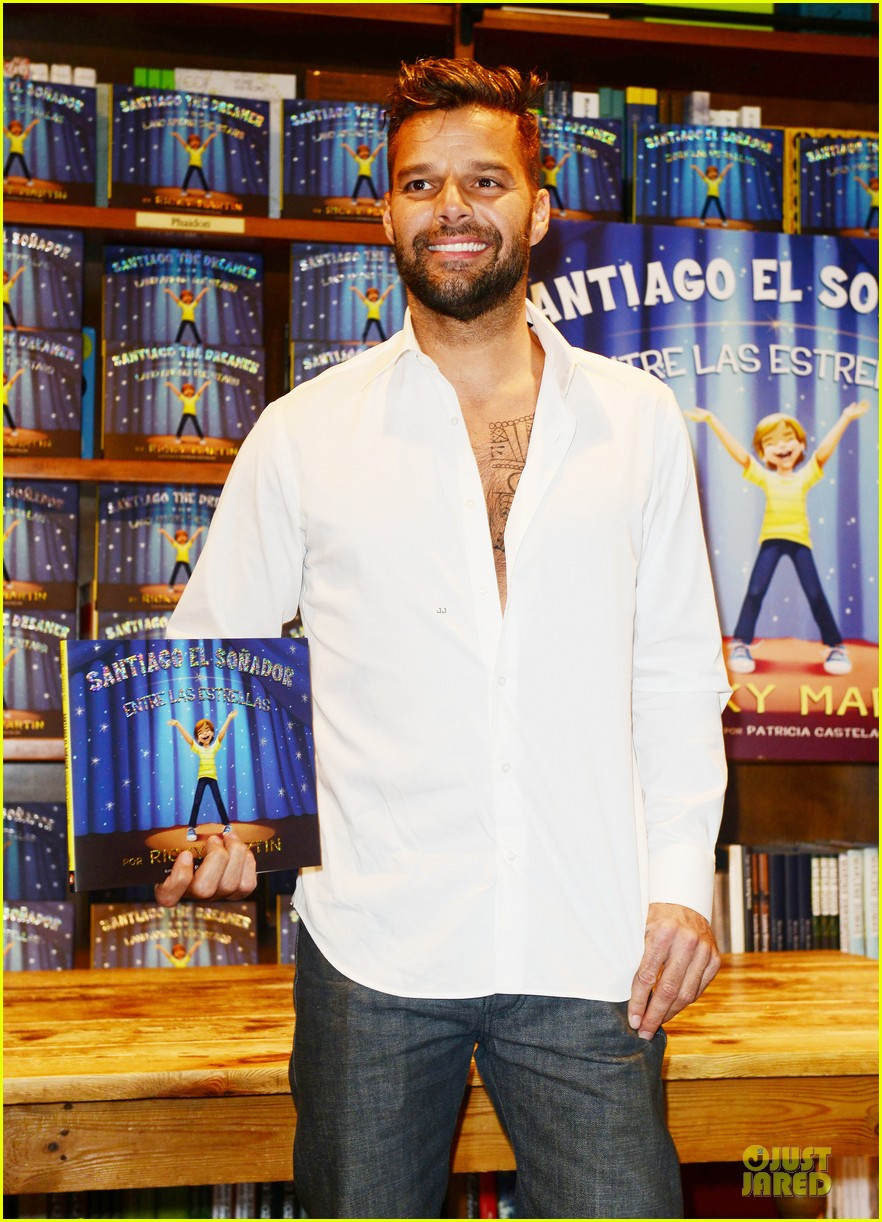 ricky martin flashes chest hair for santiago signing 07