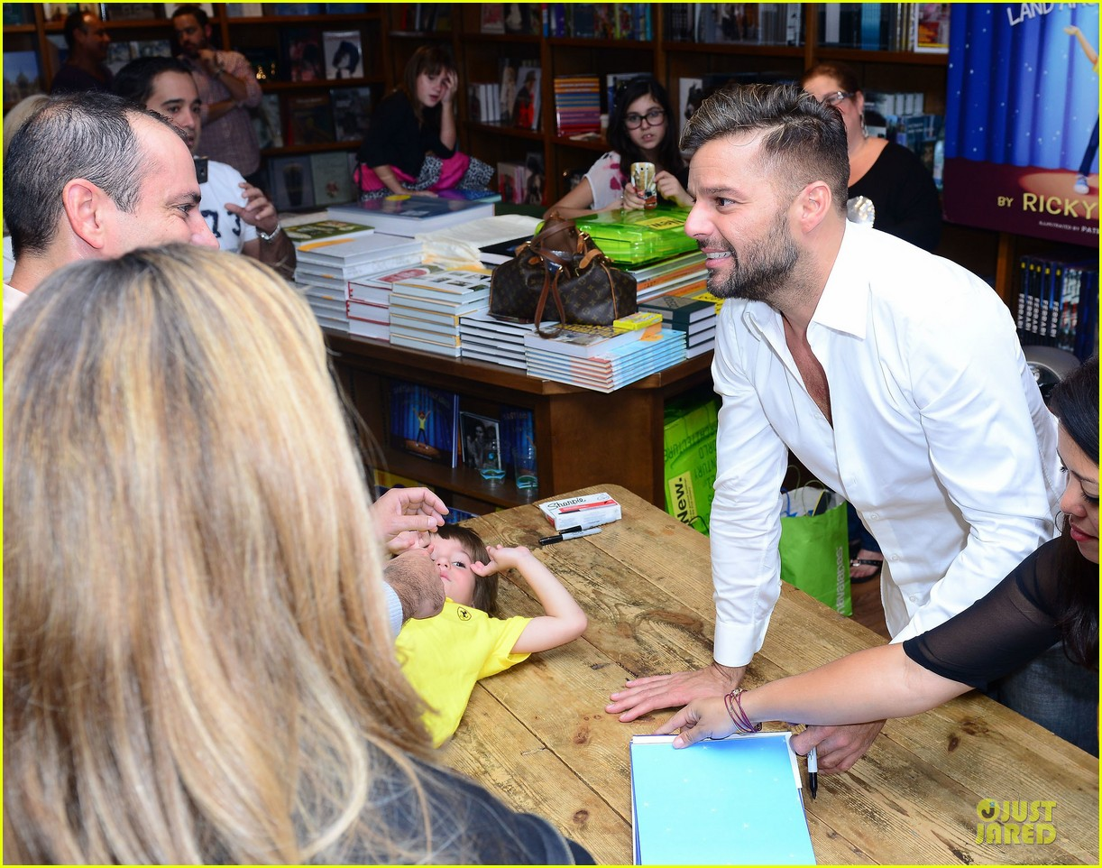 ricky martin flashes chest hair for santiago signing 10