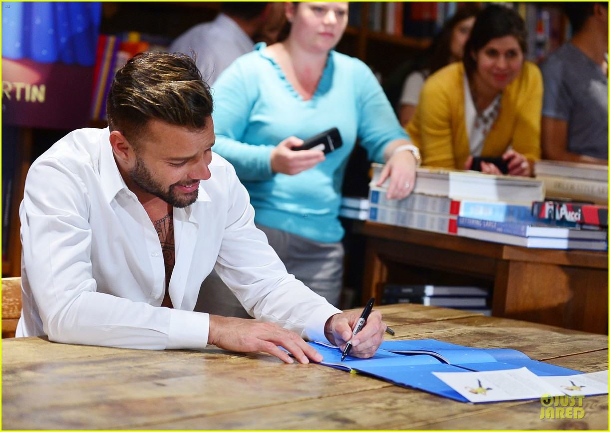 ricky martin flashes chest hair for santiago signing 172994129