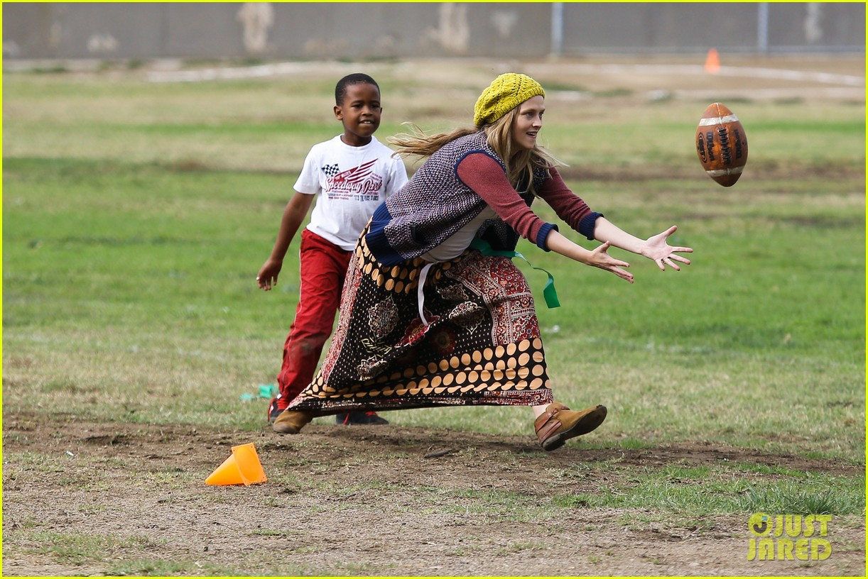 teresa palmer dives for ball during family football game 042998770