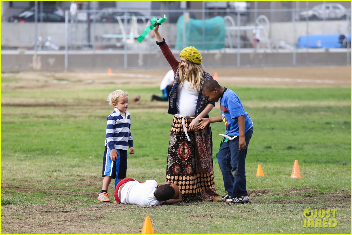 teresa palmer dives for ball during family football game 05