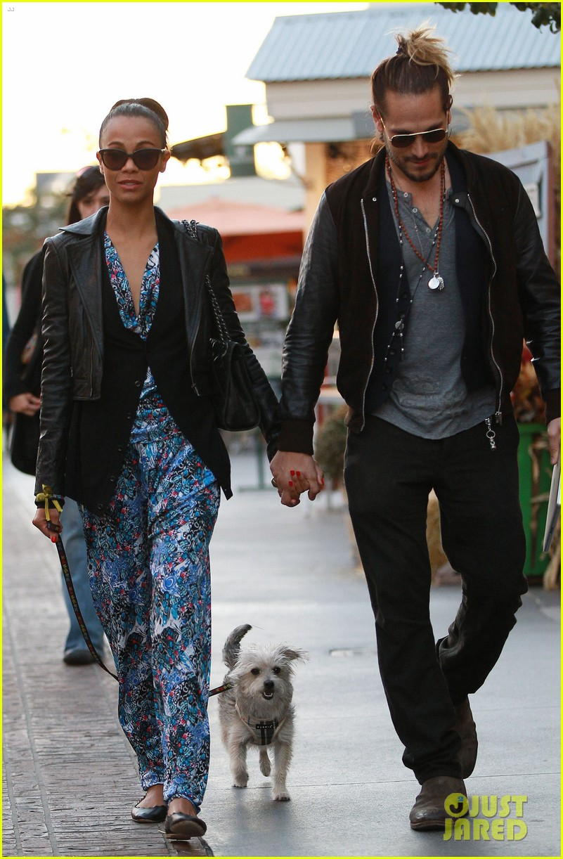 zoe saldana marco perego hold hands look so in love 172984006