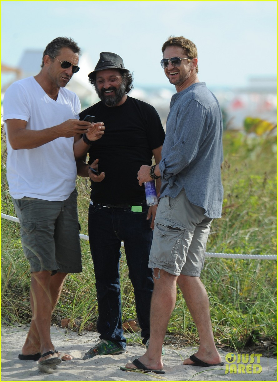 gerard butler enjoys beach time during art basel 03