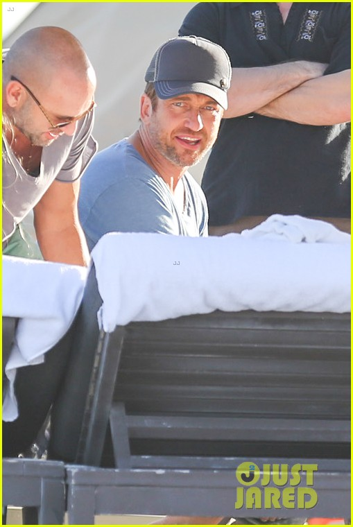 gerard butler kicks back takes photos during golf cart ride 06