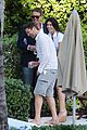gerard butler relaxes at miami hotel pool with friends 20