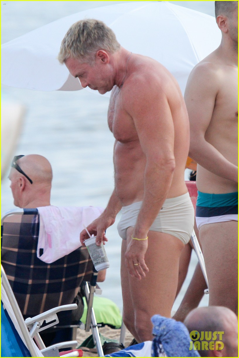 sam champion strips off board shorts to show speedo 18
