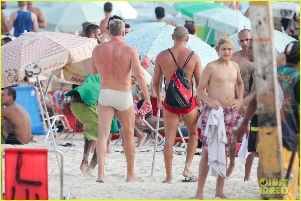 sam champion strips off board shorts to show speedo 283020047