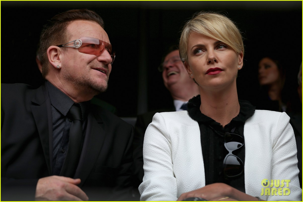 charlize theron pays respects at nelson mandela funeral 073008998