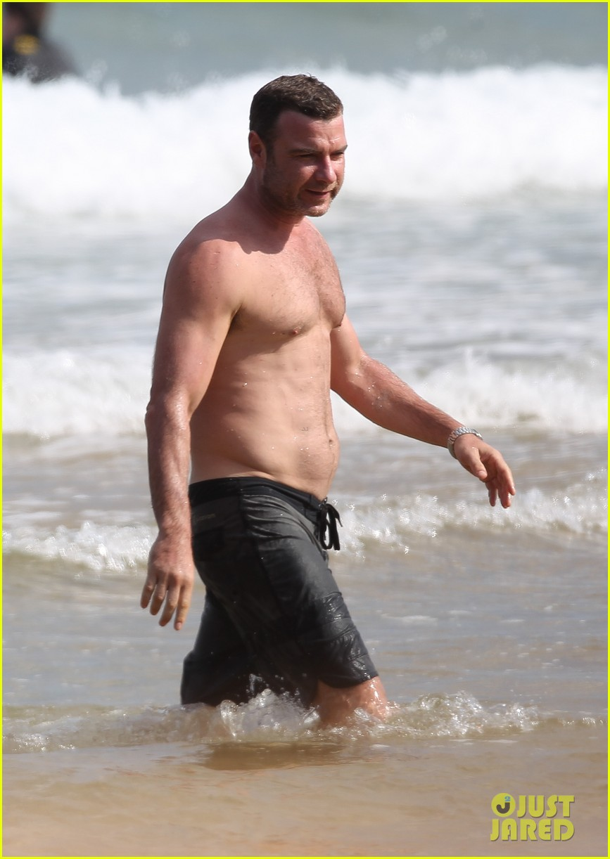 naomi watts sunbathes liev schreiber swims shirtless 113015400