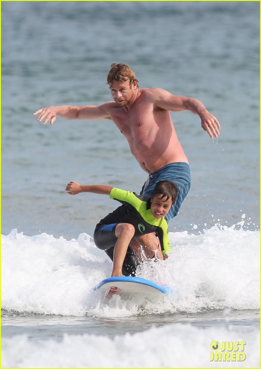 naomi watts sunbathes liev schreiber swims shirtless 273015416