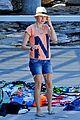 naomi watts sunbathes liev schreiber swims shirtless 05