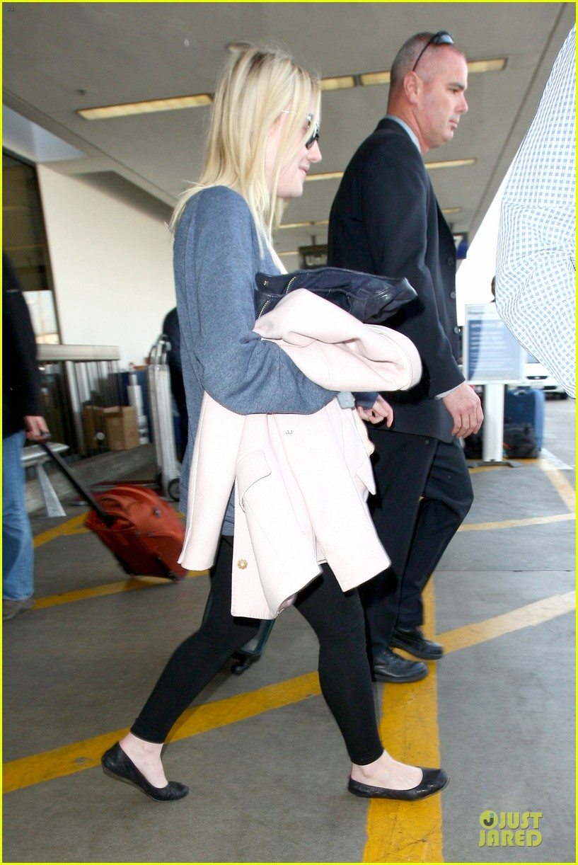 dakota fanning ends january with casual lax airport landing 03