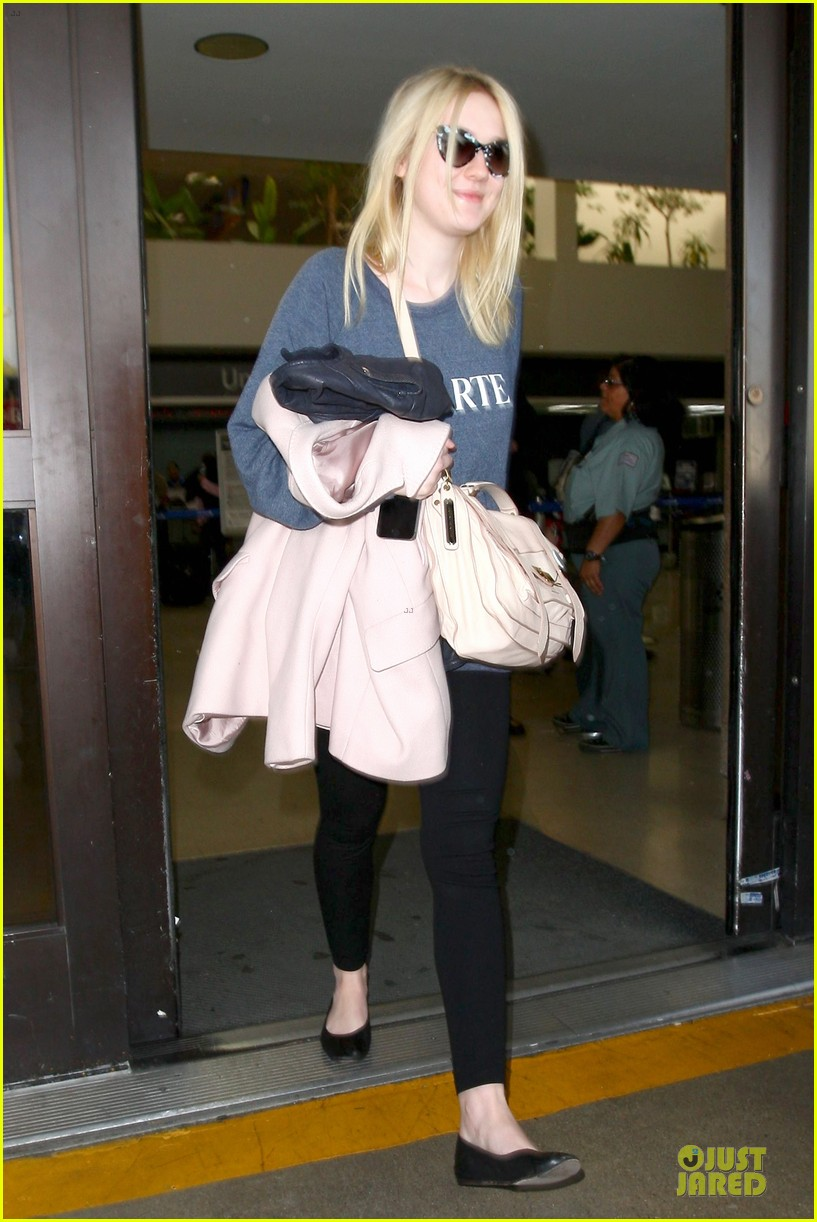 dakota fanning ends january with casual lax airport landing 05