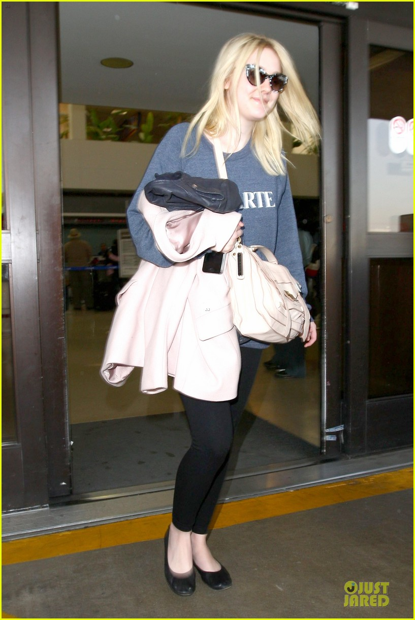 dakota fanning ends january with casual lax airport landing 13