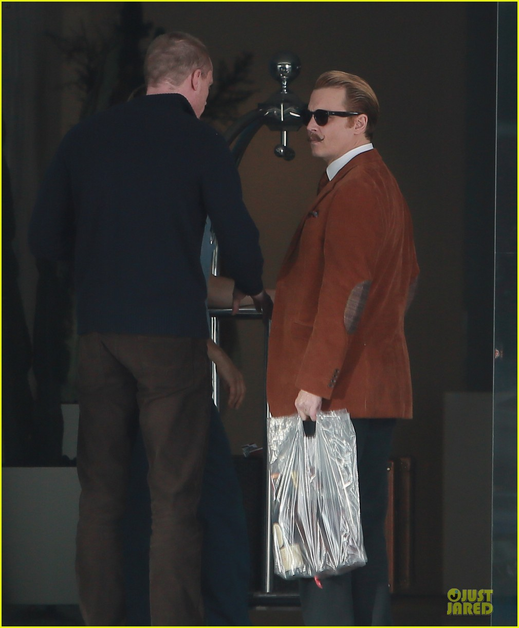 johnny depp mortdecai set with bikini clad babes 203024212