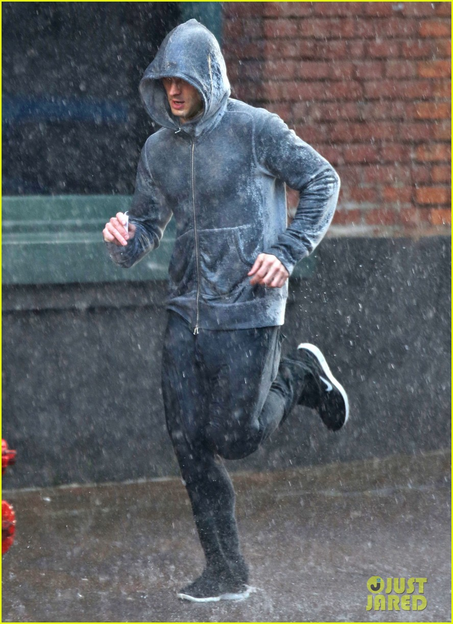 jamie dornan runs in the rain for fifty shades of grey 173043914