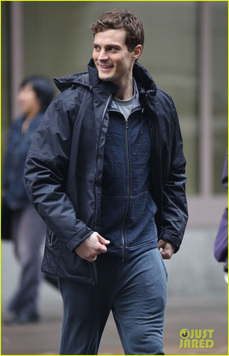 jamie dornan runs in the rain for fifty shades of grey 37