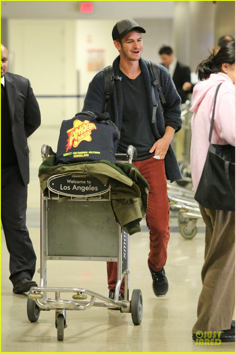 andrew garfield poses with spiderman fan at lax airport 243042328