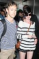 anne hathaway greets mob of fans at lax 21