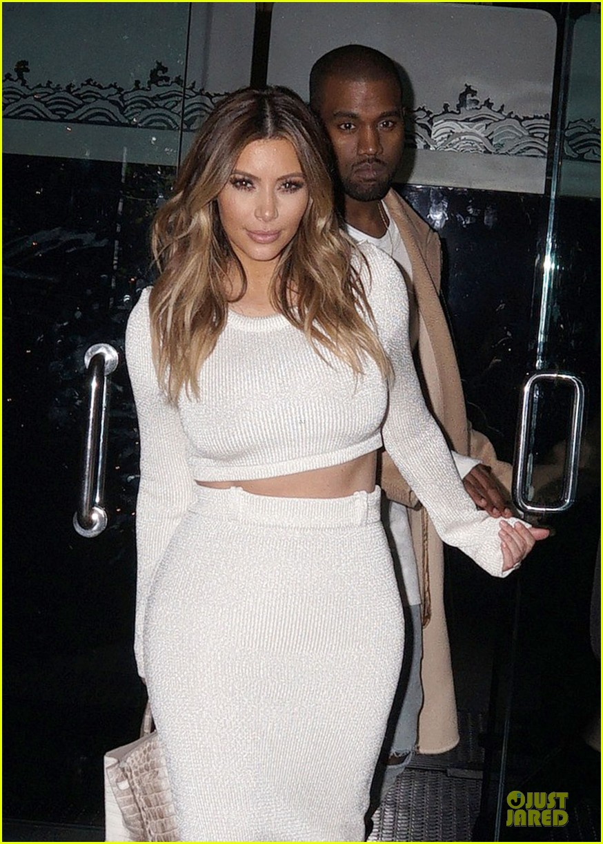 kim kardashian bares midriff for dinner with kanye west 02