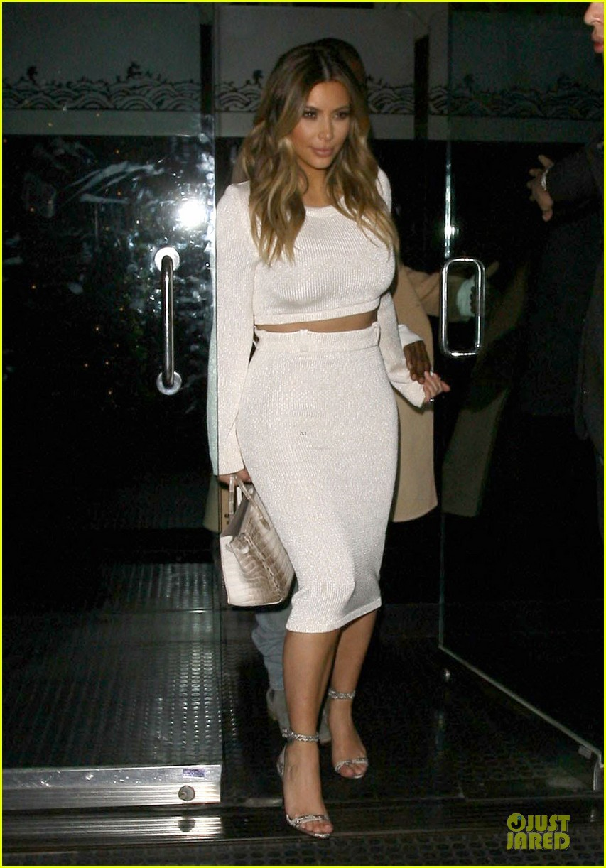 kim kardashian bares midriff for dinner with kanye west 13
