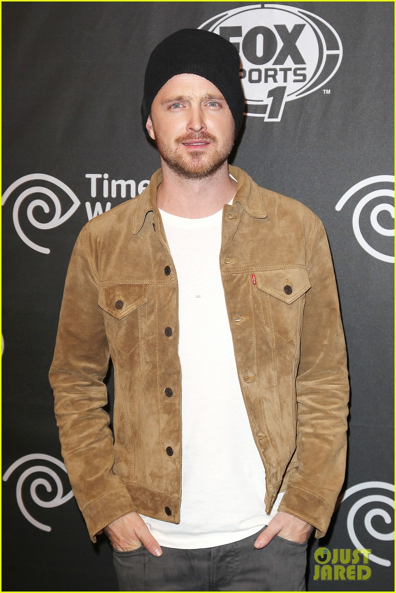 aaron paul kicks his heels up his wife seems unimpressed 163044685