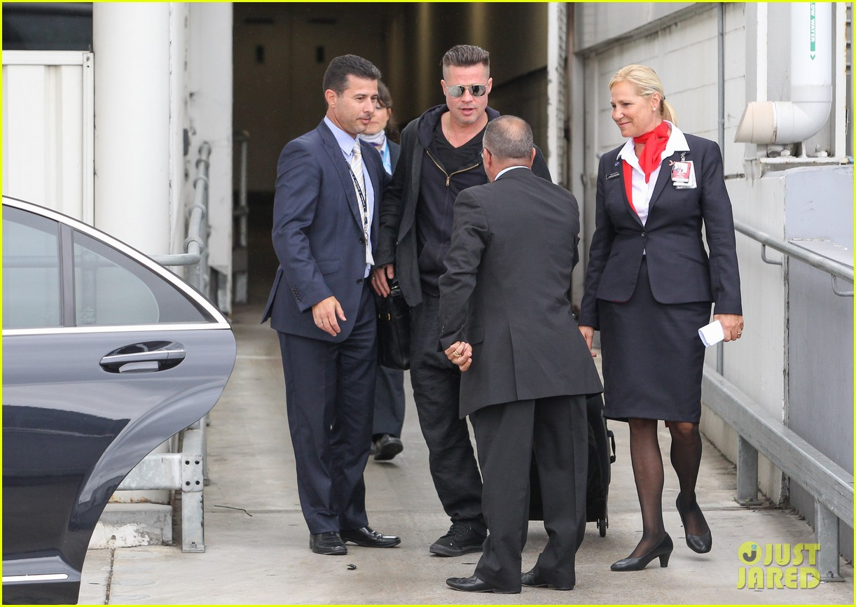 brad pitt touches down in sydney after awards weekend 10