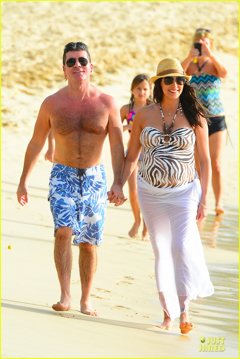 simon cowell lauren silverman hold hands on new year eve 06