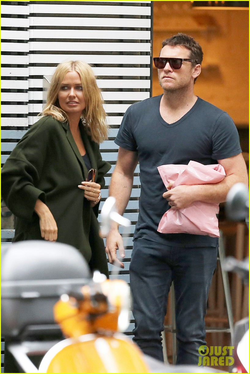 sam worthington lara bingle wear matching rings on that finger 093038655