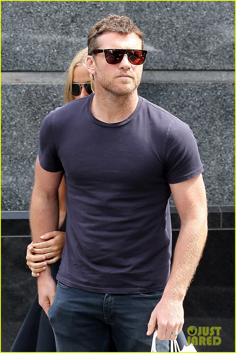 sam worthington lara bingle wear matching rings on that finger 183038664