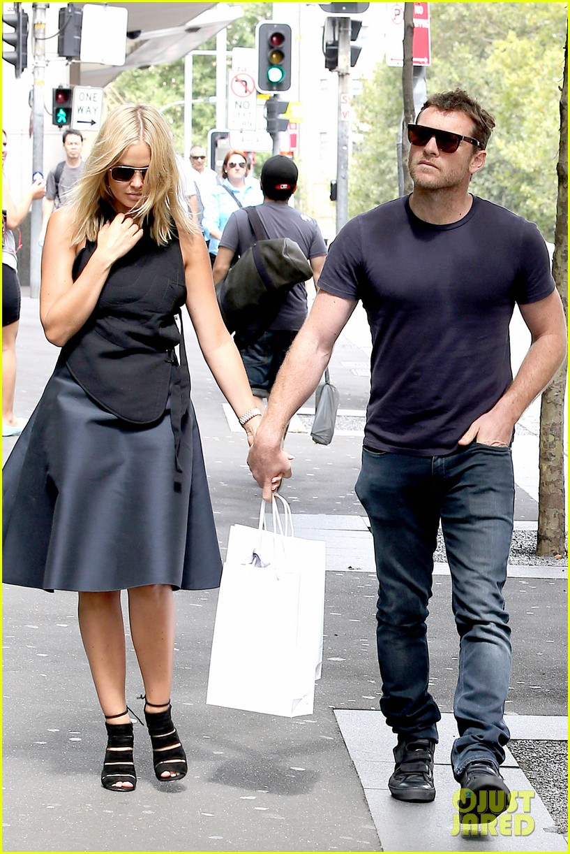 sam worthington lara bingle wear matching rings on that finger 243038670